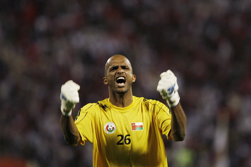 Oman's goalkeeper Ali al-Habsi celebrates after saving a penalty shot by Iraq [AFP]