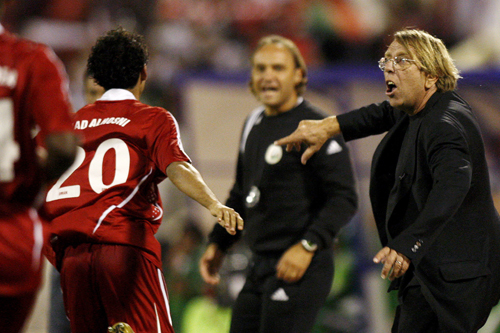 Claude Le Roy, right, coach of Oman, gets excited by the action [AFP]