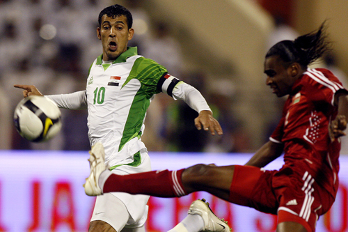 Oman's Ahmed Mubark, right, vies with Iraq's Yunes Mahmoud [AFP]