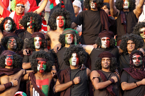 Omani supporters get fired up before the match against Bahrain [AFP]
