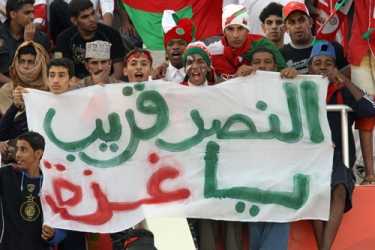 Proving politics and sport inevitably mix: Omani supporters hold placards reading 'victory soon for Gaza' [AFP]