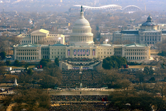 Crowds estimated at more than a million packed into Washington DC's mall to watch the inauguration ceremony [AFP]