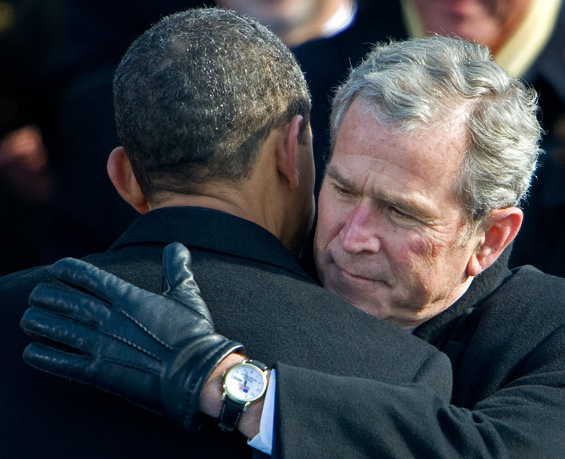 Handing over: George Bush, leaving office as one of the least popular presidents in US history, congratulates his successor [AFP]