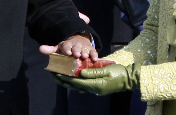 "Obama took the oath of office with his hand on a bible first used by Abraham Lincoln, the US president credited with bringing an end to what he called ""the monstrous injustice of slavery"" [AFP]"