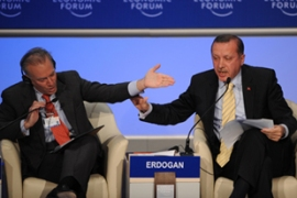 Erdogan, right, was angered by the moderator not giving him a chance to counter Peres' argument [AFP]