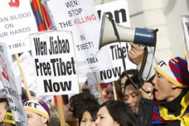 About 200 demonstrators gathered outside the Chinese embassy in London on Sunday [Reuters]