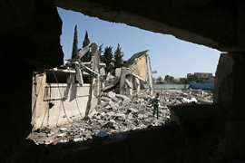 The report said UK arms were almost certainly used by Israeli forces during the recent conflict in Gaza [AFP]
