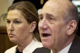 Olmert, right, and Livni used a cabinet meeting to threaten severe action against Hamas [Reuters]