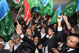 Thousands of lawyers and opposition supporters celebrated the move to restore Chaudhry [AFP]