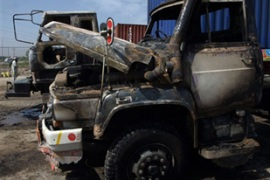Taliban fighters destroyed eight Nato supply trucks at a transport terminal near Peshawar [AFP]