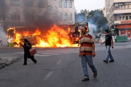Protesters fought back with stones and set fires in the streets of the capital, Tehran [AFP]