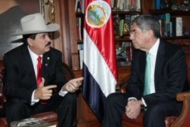 Zelaya, left, met Arias in San Jose and reiterated his demand to be reinstated immediately [AFP]