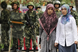 Tensions between Xinjiang's Uighur Muslims and Han Chinese exploded into violence on July 5 [AFP]