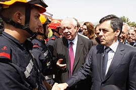 Fillon, right, promised that the seven legionnaires involved in the incident would be punished [EPA]