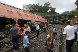 Chinese state media said the trail derailed in Liuzhou city in the Guangxi region [Reuters]