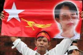 Opposition leader Aung San Suu Kyi has been under detention for 14 of the past 20 years [EPA]