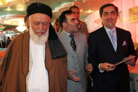 Rabbani, left, is supporting the presidential bid of Abdullah Abdullah, right [EPA]