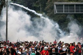 Tear gas and water cannon were fired to disperse the protesters before their planned march [Reuters]