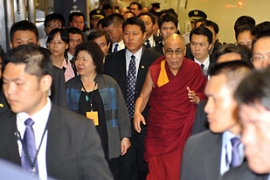 Supporters of the Dalai Lama and pro-China protesters were at the airport for his arrival [AFP]
