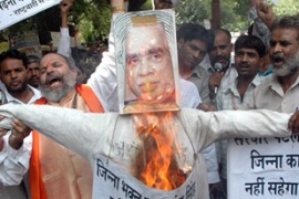 The book sparked protests in New Delhi by right-wing activists who burnt an effigy of Singh [EPA]