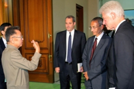 Clinton, right, secured the release of two US journalists after talks with Kim Jong-il [AFP]