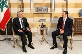Hariri, right, announced his decision in a meeting with Michel Suleiman, the president, left [AFP]