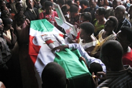 The funeral of the 12 Burundian peacekeepers killed in the twin suicide bombing was held on Sunday [AFP]