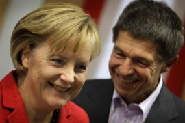 Merkel, seen here with her husband, warned 'there are many problems in our country to be solved' [Reuters]