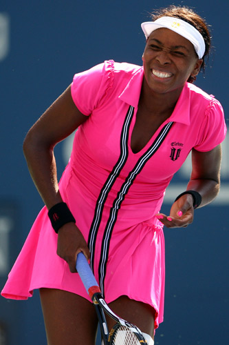 Venus Williams makes sure no one can miss her in this pink number [GALLO/GETTY]
