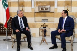Al-Hariri, right, handed his proposal to the President without the agreement of the opposition [EPA]