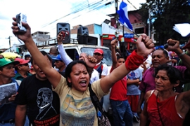 Protests have been a near daily occurrence in Honduras since the coup [AFP]
