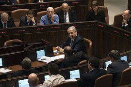 Netanyahu, centre, said the UN report and committee were 'distorted' [AFP]