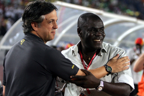 It's all smiles as Brazil's head coach Rogerio greets Ghana's coach Sellas Tetteh [GALLO/GETTY]