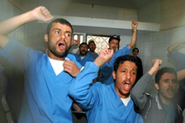 The fighters shouted slogans in court after being sentenced [EPA]
