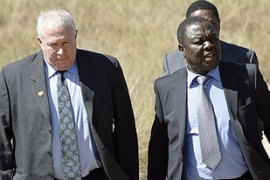 "Roy Bennett, left, faces terrorism charges which Morgan Tsvangirai, right, described as ""fiction"" [AFP]"