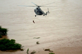 Air force helicopters are dropping food and drinking water packages to those marooned [AFP]