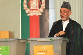 Karzai agreed to take part in a second and decisive round of voting after talks with US officials [AFP]