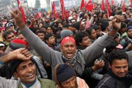 Tens of thousands of Maoists surrounded government buildings in Kathmandu [AFP]
