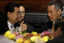 Hu Jintao, left, shares his vision for a sustained global economic recovery with Asia-Pacific leaders [Reuters]