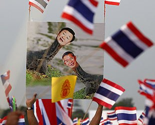 The protesters expressed anger over Thaksin's new job and his comments on the monarchy [Reuters]