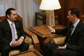 Al-Hariri, left, stressed the need for relations with Damascus during talks with Syria's president [AFP]