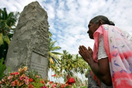 A memorial was held in Sri Lanka for the 1,200 people killed when the waves hit a train [Reuters]