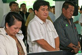 Andal Ampatuan Sr, right, and his clan are known to be closely-linked to Arroyo, left [EPA]