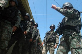 Hundreds of army and police personnel took part in the raids on the Ampatuan family compound [AFP]