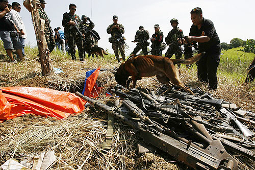 The Philippines military has shown firearms, crates of ammunition and mortar shells they say were seized from a farm belonging to the the Ampatuan clan near the provincial capital [Reuters]