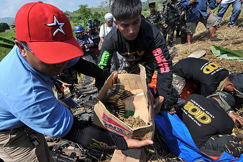 Officials said the weapons stockpile, some bearing the stamp of the Philippines defence department, were enough to arm a battalion [EPA]