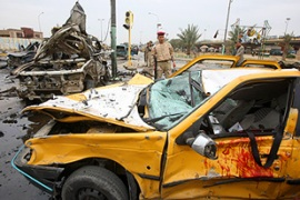 The poll date announcement was overshadowed by a series of car bombings in Baghdad [AFP]