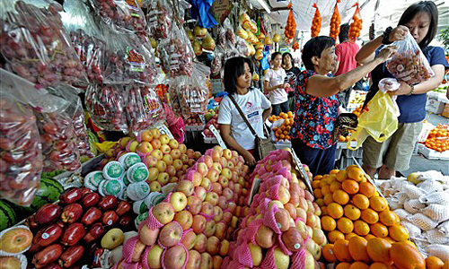 Some Filipinos believe that displaying 12 different round-shaped fruits at home before New Year''s Day welcomes prosperity [AFP]
