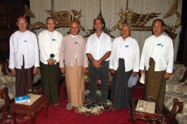 Tomas Quintana, centre, met members of the oppostion NLD on Thursday [AFP]
