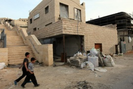 Israel rejects settlement halt